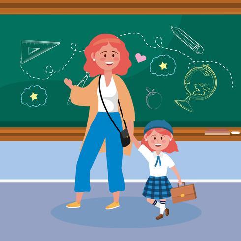 Madre y niña estudiante con el pelo rojo en el aula