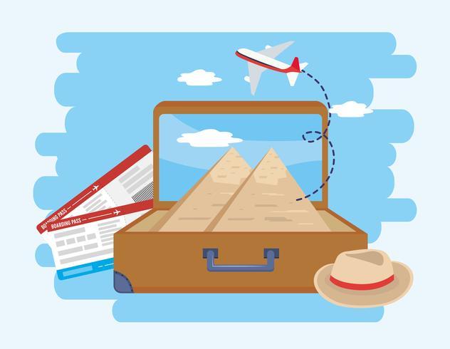 Mala com pirâmides egípcias e bilhetes de avião