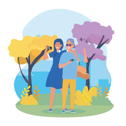 Young couple taking selfie in park