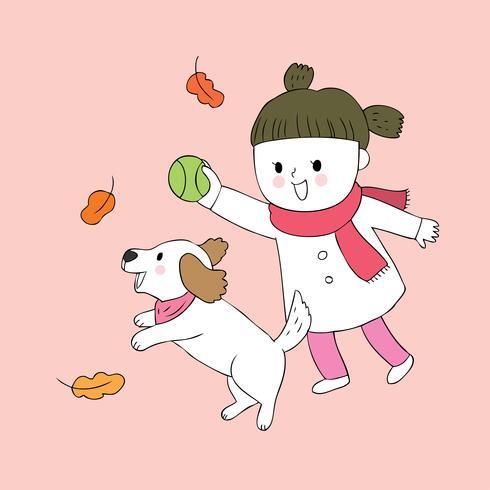 meisje en hond spelen bal