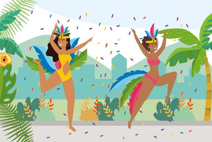 Vrouwelijke carnaval dansers met confetti buiten