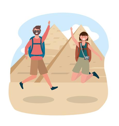 Tourist couple jumping in front of Egyptian pyramids