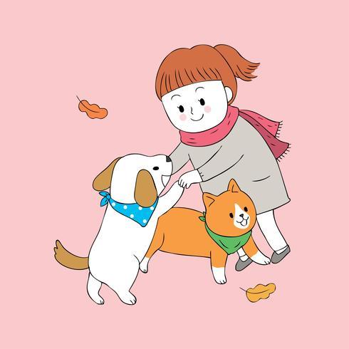 meisje en hond en kat spelen
