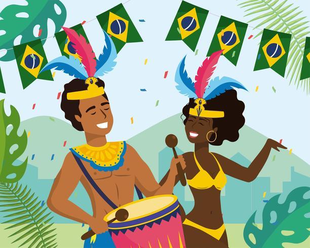 Musicista e ballerino maschio e femmina di carnevale con la bandiera brasiliana della bandiera