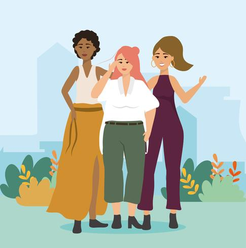 Drie verschillende moderne vrouwen in vrijetijdskleding in park