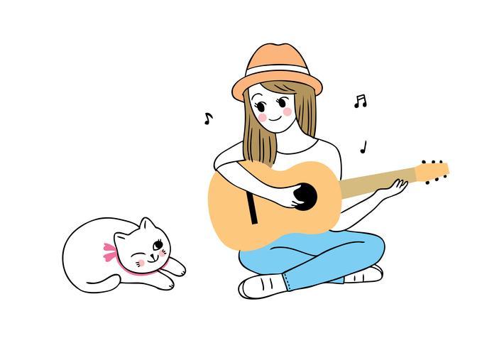 donna che suona la chitarra e il gatto