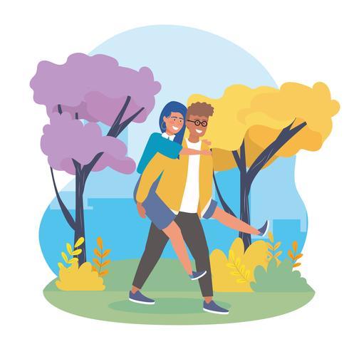 Man dragende vrouw terug in park