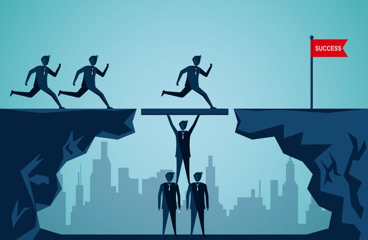 Businessmen working together to make a bridge on a mountain and reach the goal
