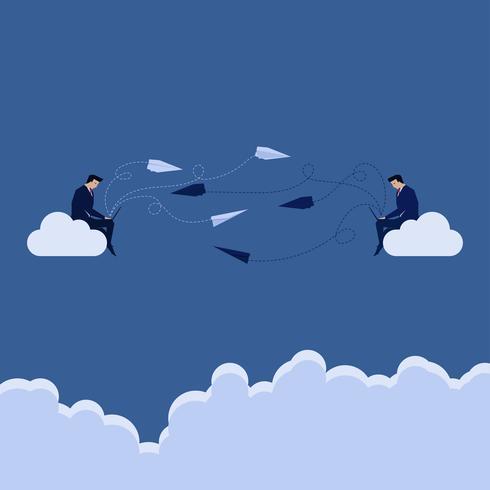 Due uomini d'affari seduto sul cloud inviandosi l'un l'altro messaggio dal computer portatile
