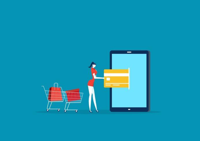 Señora comprando y pagando con tarjeta de crédito vía móvil vector