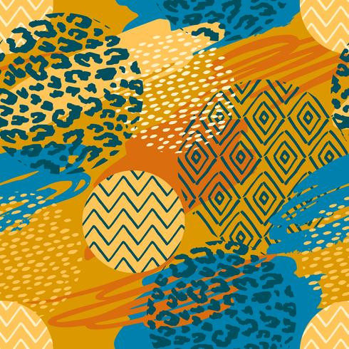 Tribal ethnic seamless pattern with animal print and brush strokes. vector