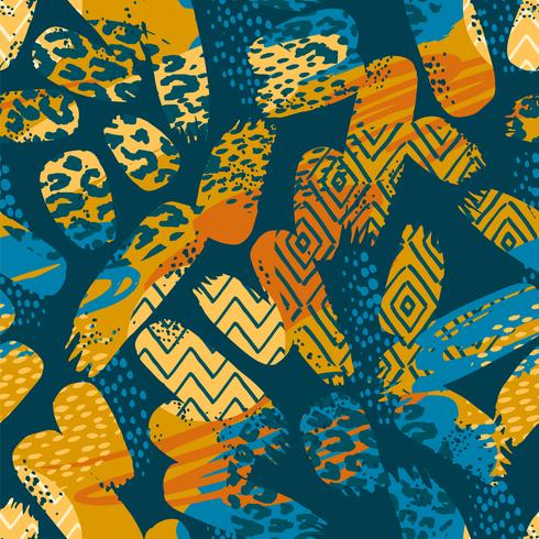 Tribal ethnic seamless pattern with animal print and brush strokes vector