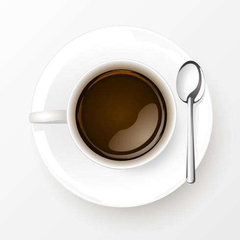 Xícara de café com colher isolado no fundo branco