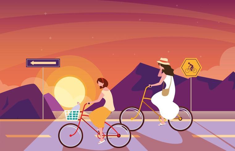 femmes à vélo dans le paysage du lever du soleil avec la signalisation pour cycliste vecteur