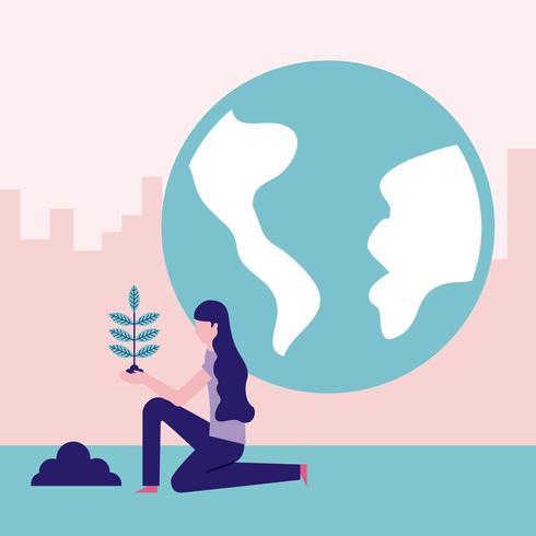 Donna che pianta albero con il globo nel fondo