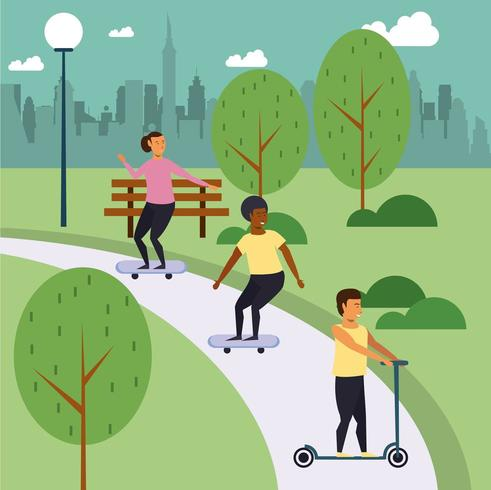 Teenagers skateboarding in park