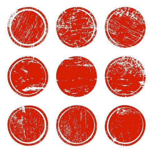 Uppsättning av röda grungetexturcirklar