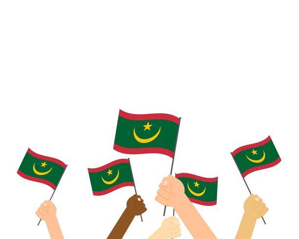Mãos segurando bandeiras da Mauritânia