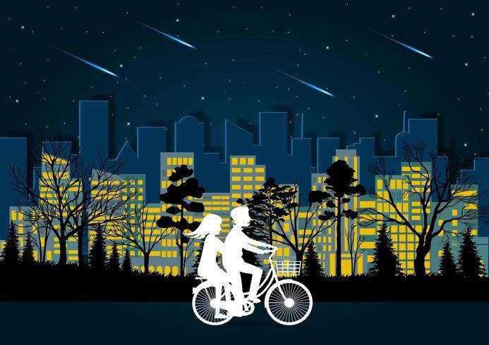 Mannen en vrouwen fietsen 's nachts op de weg vector