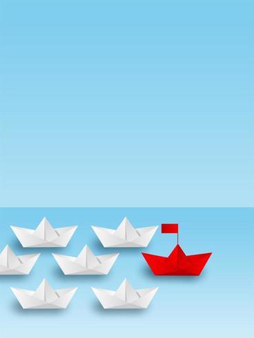 Rött pappersbåt som leder vitbåtfartyg till goa