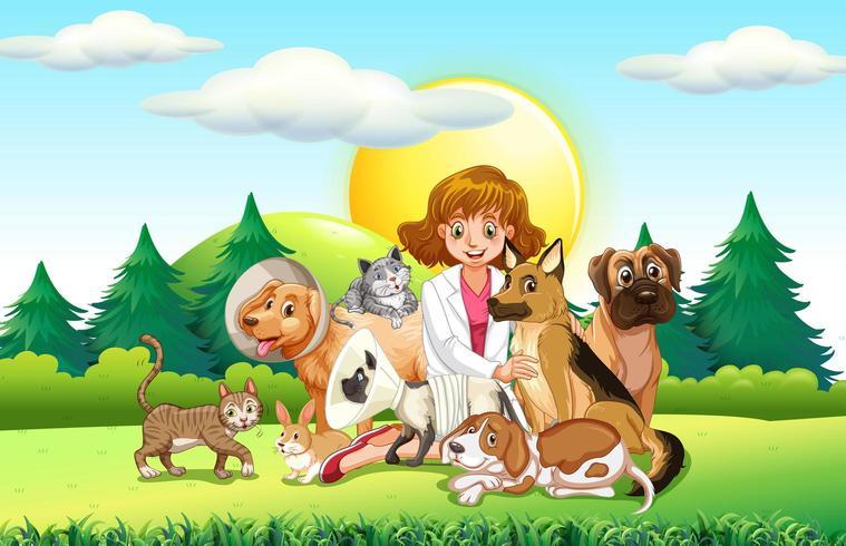 Vrouwelijke dierenarts en veel dieren