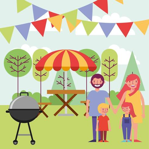 Family Enjoying Grill Out in Park