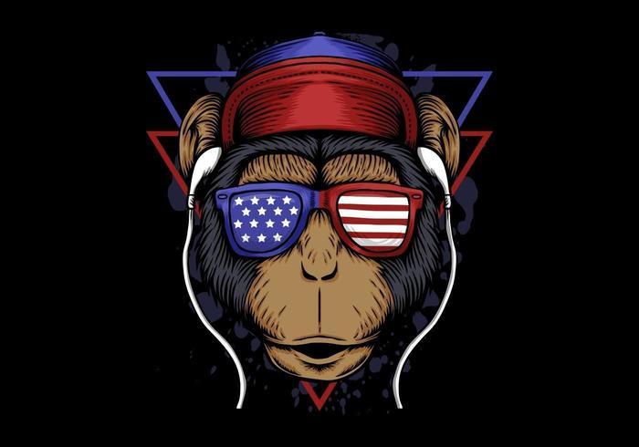 Affe, der auf die Kopfhörer tragen Sonnenbrillen der amerikanischen Flagge hört