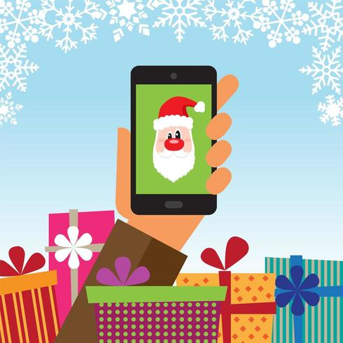 Hand holding a mobile phone with gifts and Santa Claus on the device