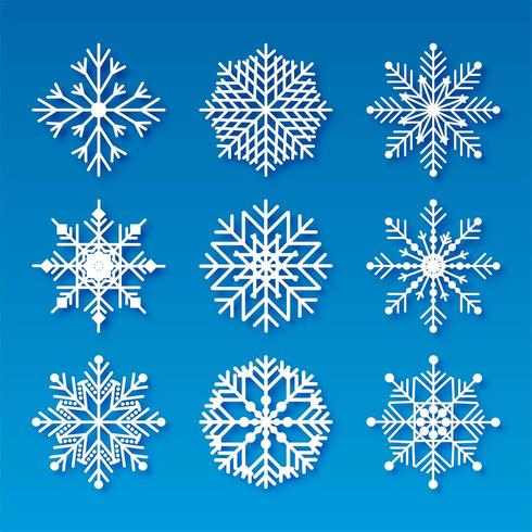 Los copos de nieve decorativos de Navidad establecen diseño de elementos
