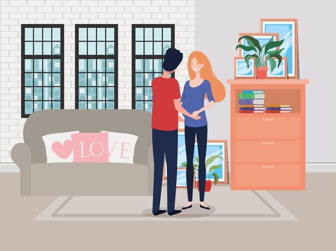 pareja de embarazo en la sala de estar