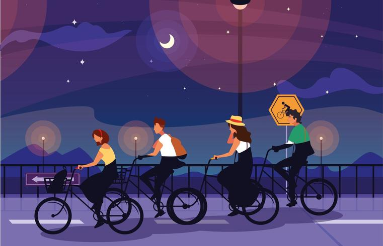 gente montando bicicleta en la noche vector