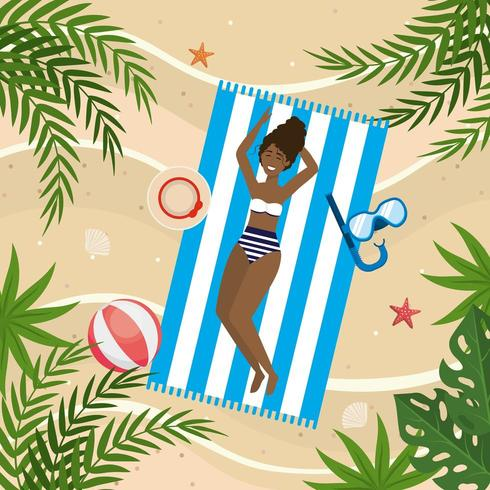 woman taking sun with snorkel masks and hat in the towel vector