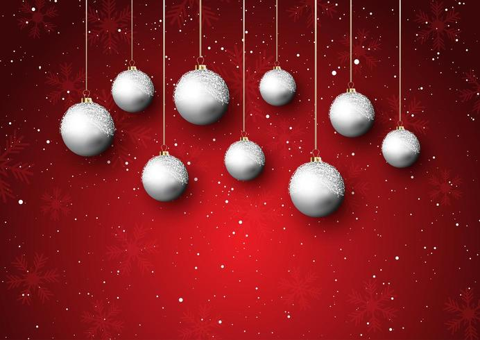 Christmas baubles on a snowy background vector