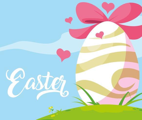 uovo di Pasqua decorato con fiocco in erba
