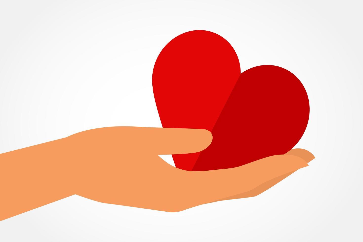 corazón de mano vector