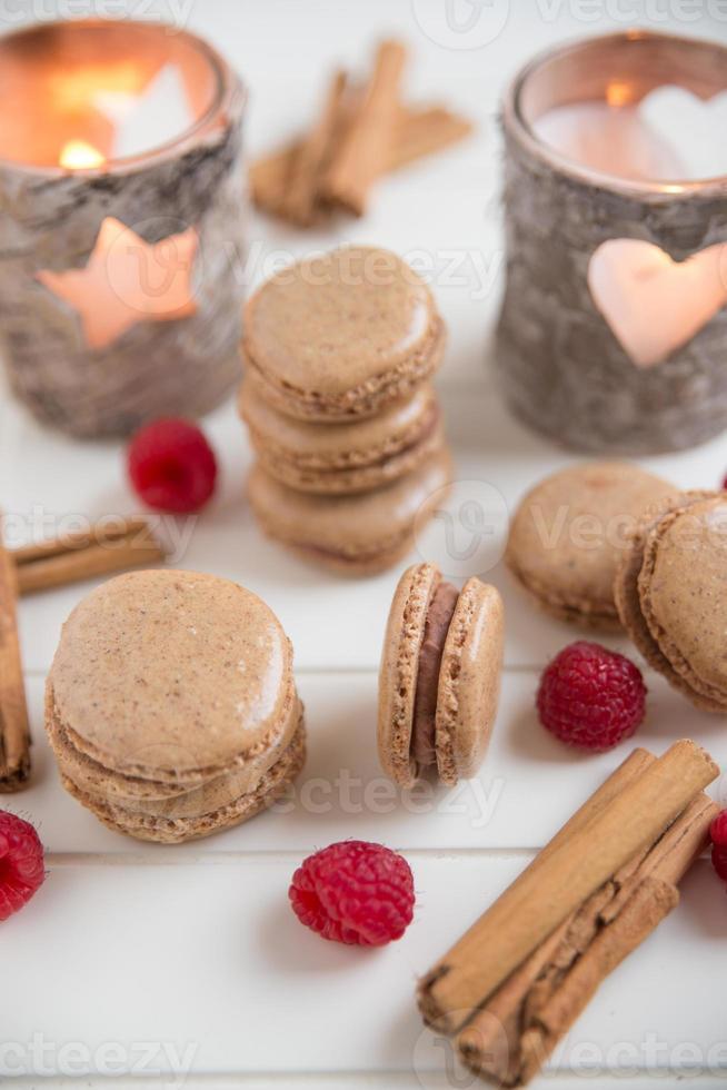 Cinnamon Macarons filled with chocolate raspberry ganache photo