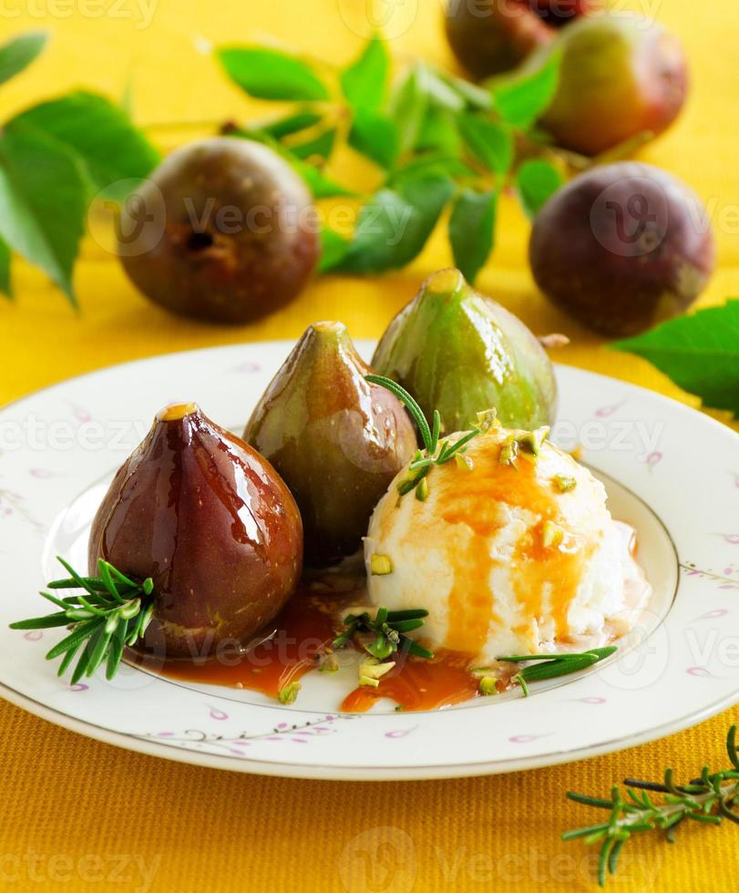 Baked figs with caramel and ice cream. photo