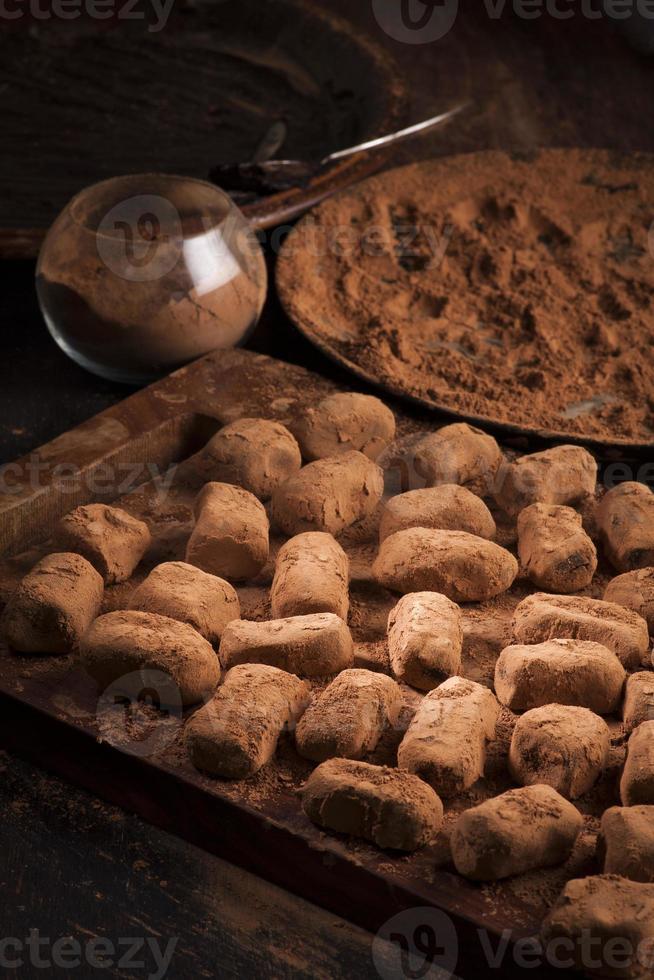 chocolate truffles in cocoa powder photo