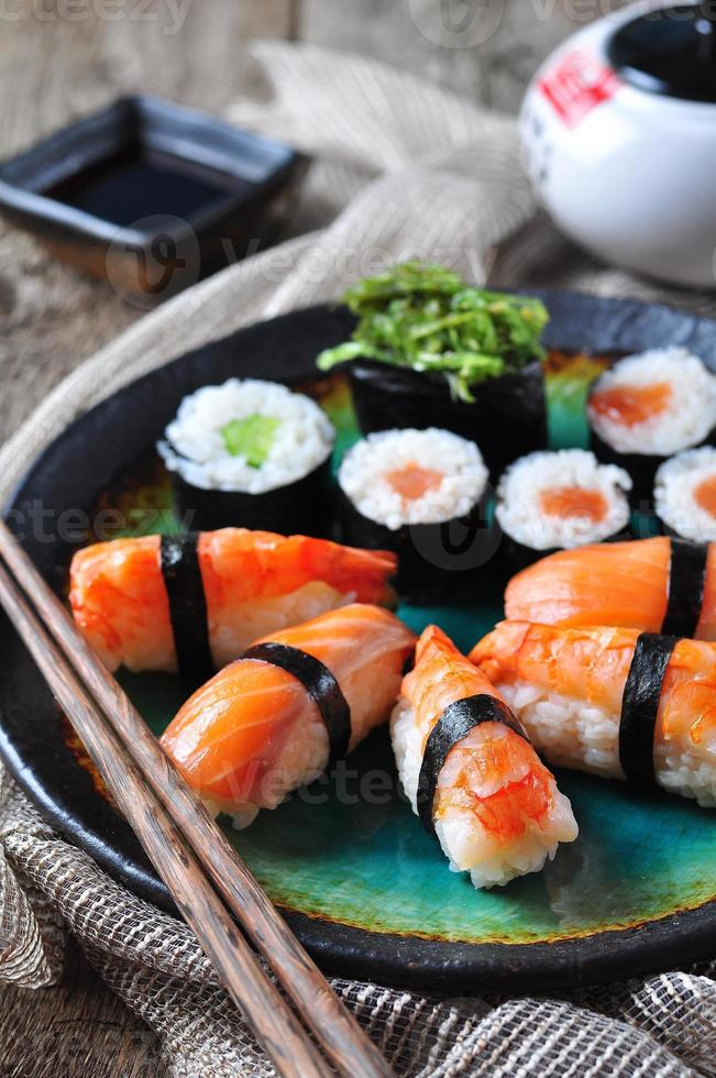 homemade sushi with wild salmon, shrimp, cucumber and seaweed photo