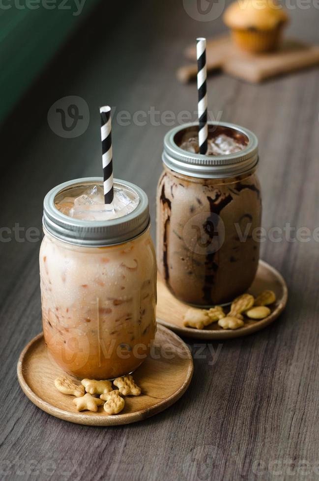 Iced coffee with milk in vintage jar photo