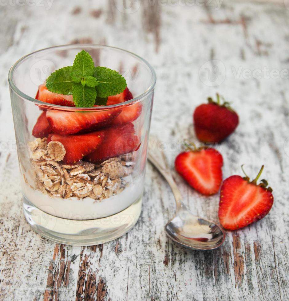 strawberry yogurt with muesli photo