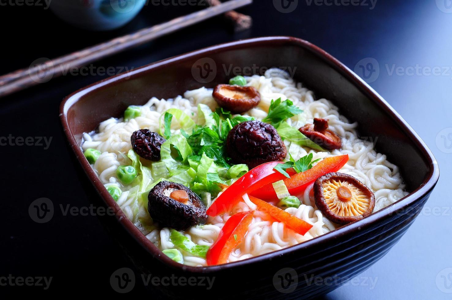 ramen noodles with shiitake mushrooms, green peas, sweet pepper, coriander photo