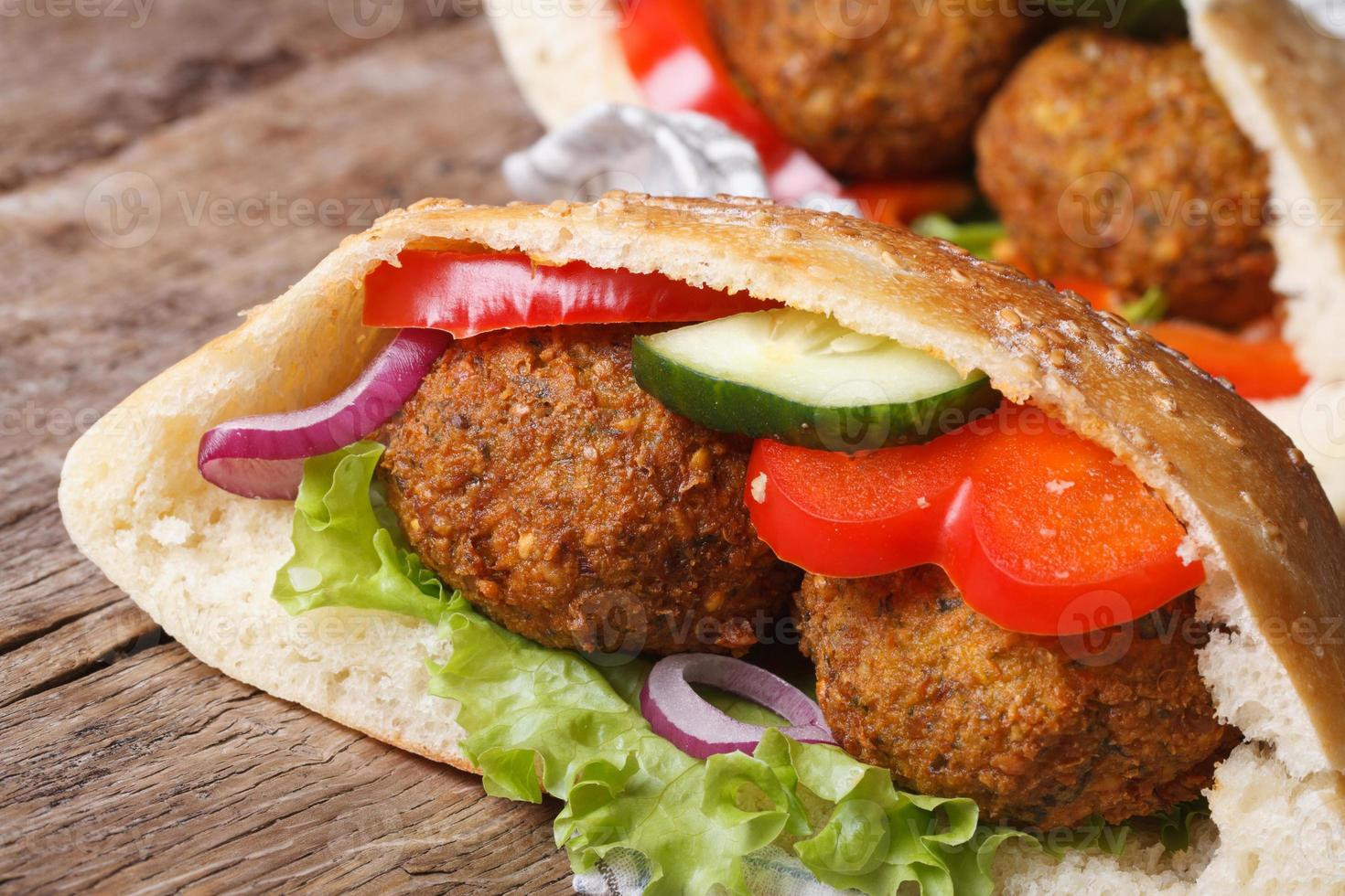 falafel in pita bread close-up on wooden table horizontal photo