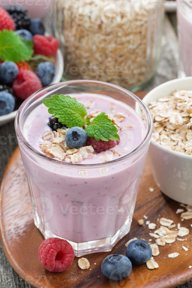 berry smoothie with oatmeal in a glass, vertical, top view photo