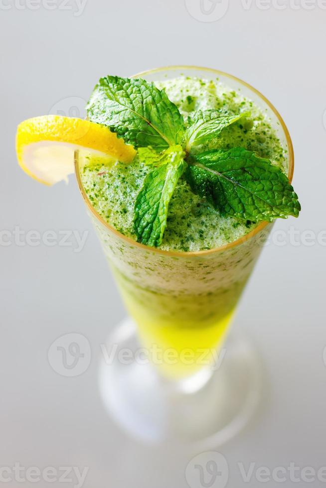 Mojito cocktail close up with fresh mint leaves photo