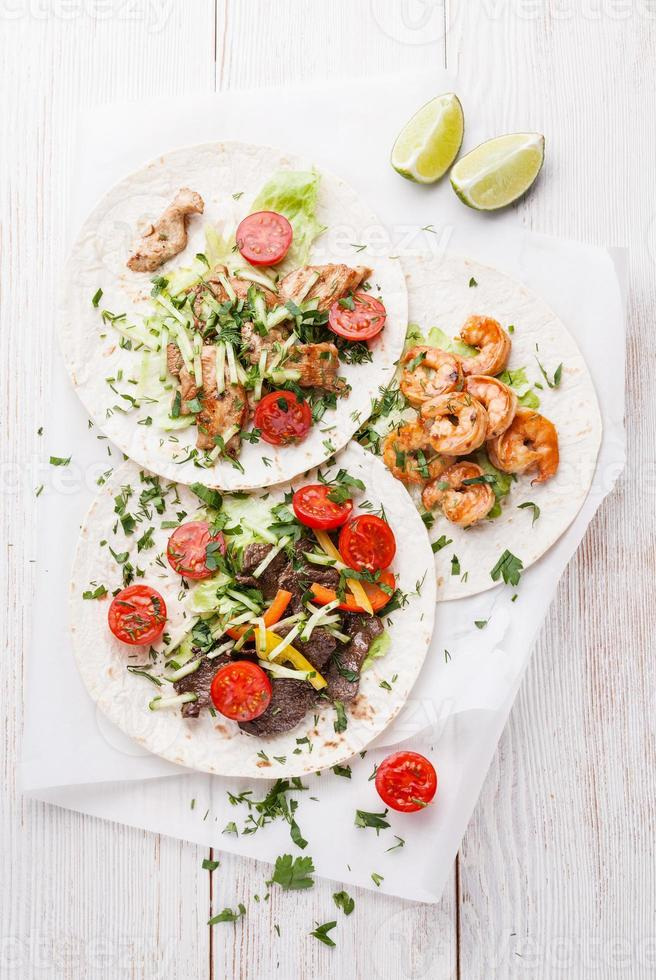 Tortillas with beef, chicken and shrimps photo