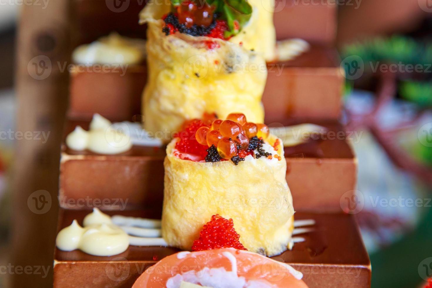 egg and cheese roll with salmon egg sushi Japanese food photo