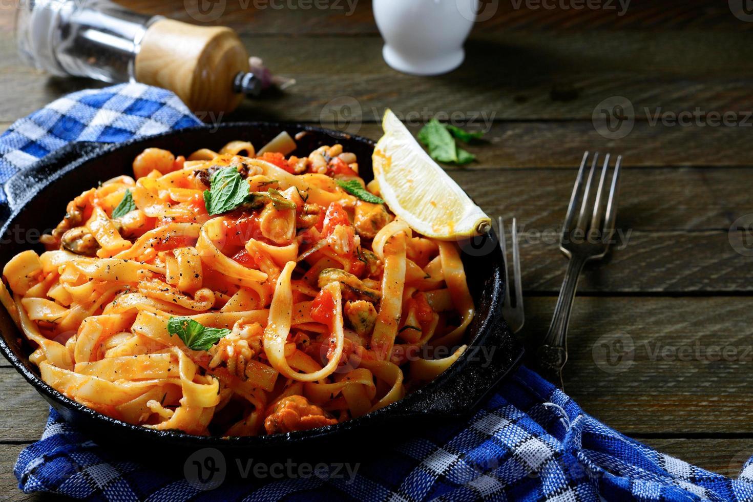 Spaghetti with seafood in a pan photo