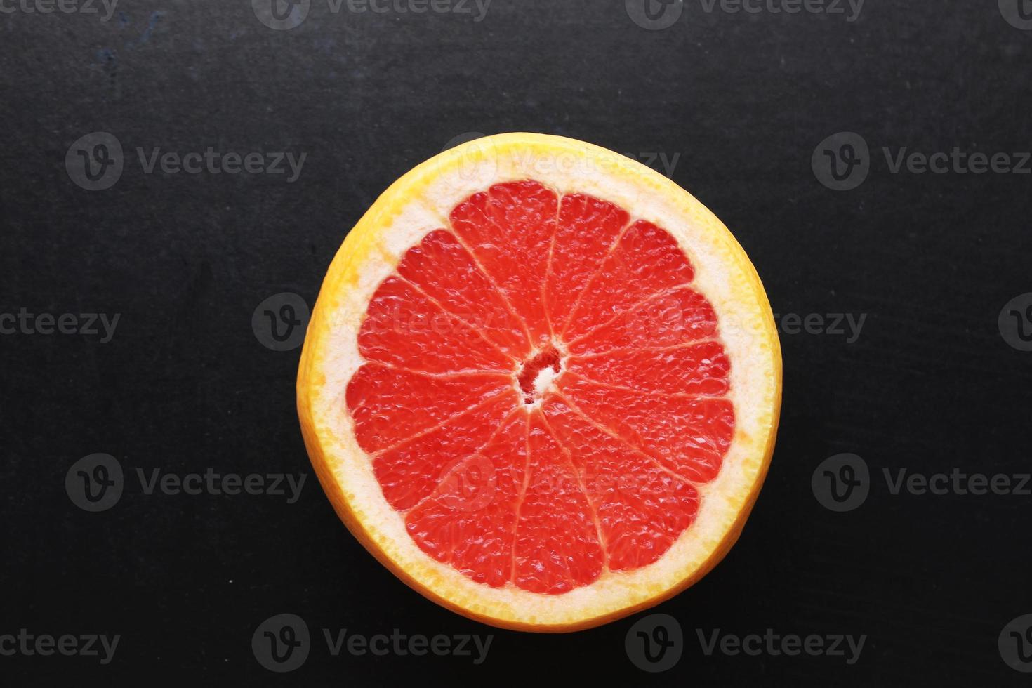 Slice of grapefruit photo