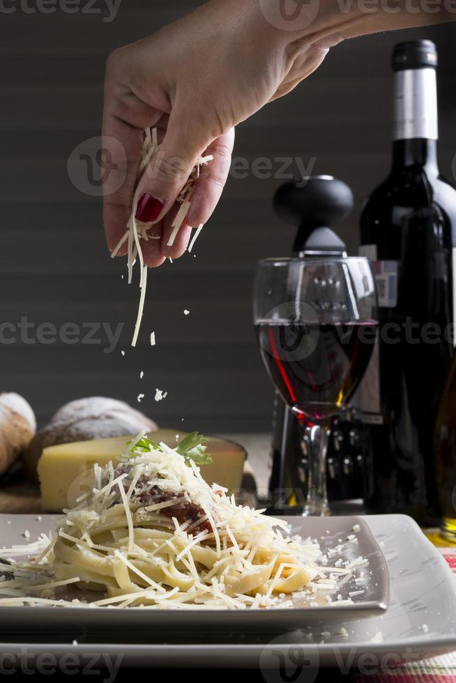 Spaghetti with Tomatoe Sauce with cheese photo
